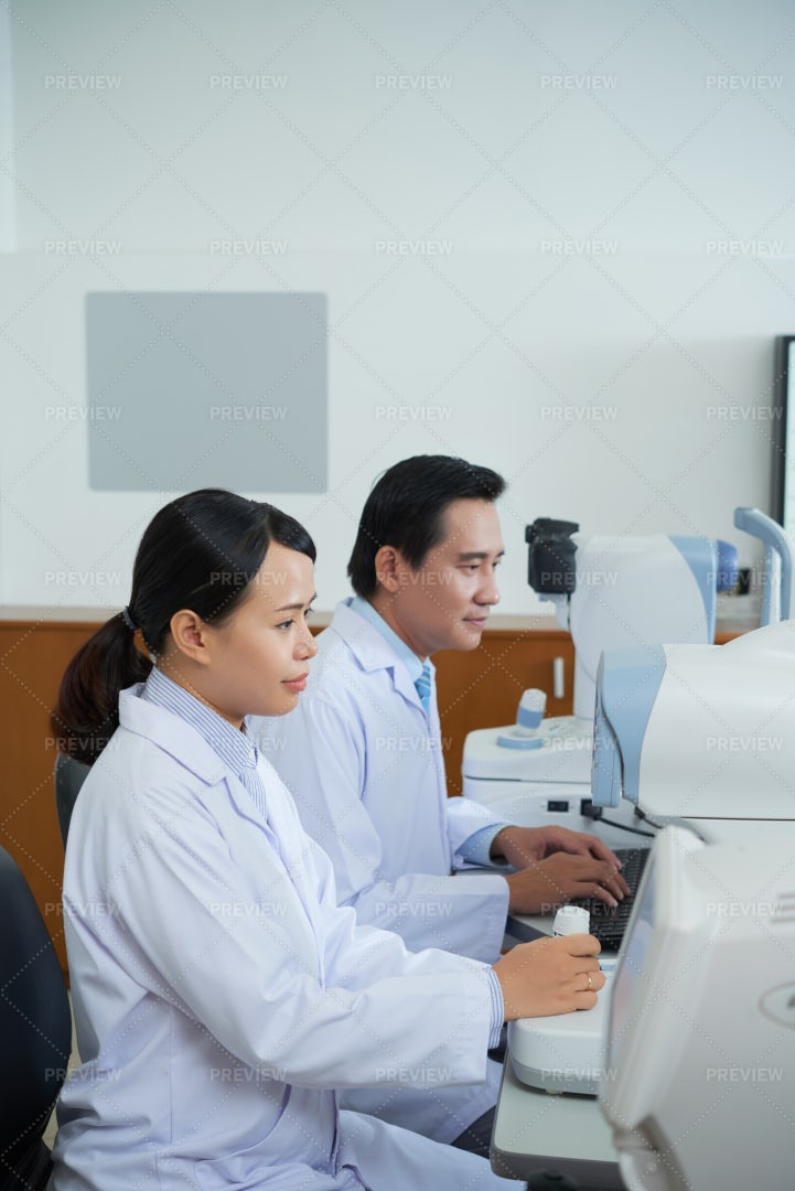 Two Doctors Working In Team At Office: Stock Photos