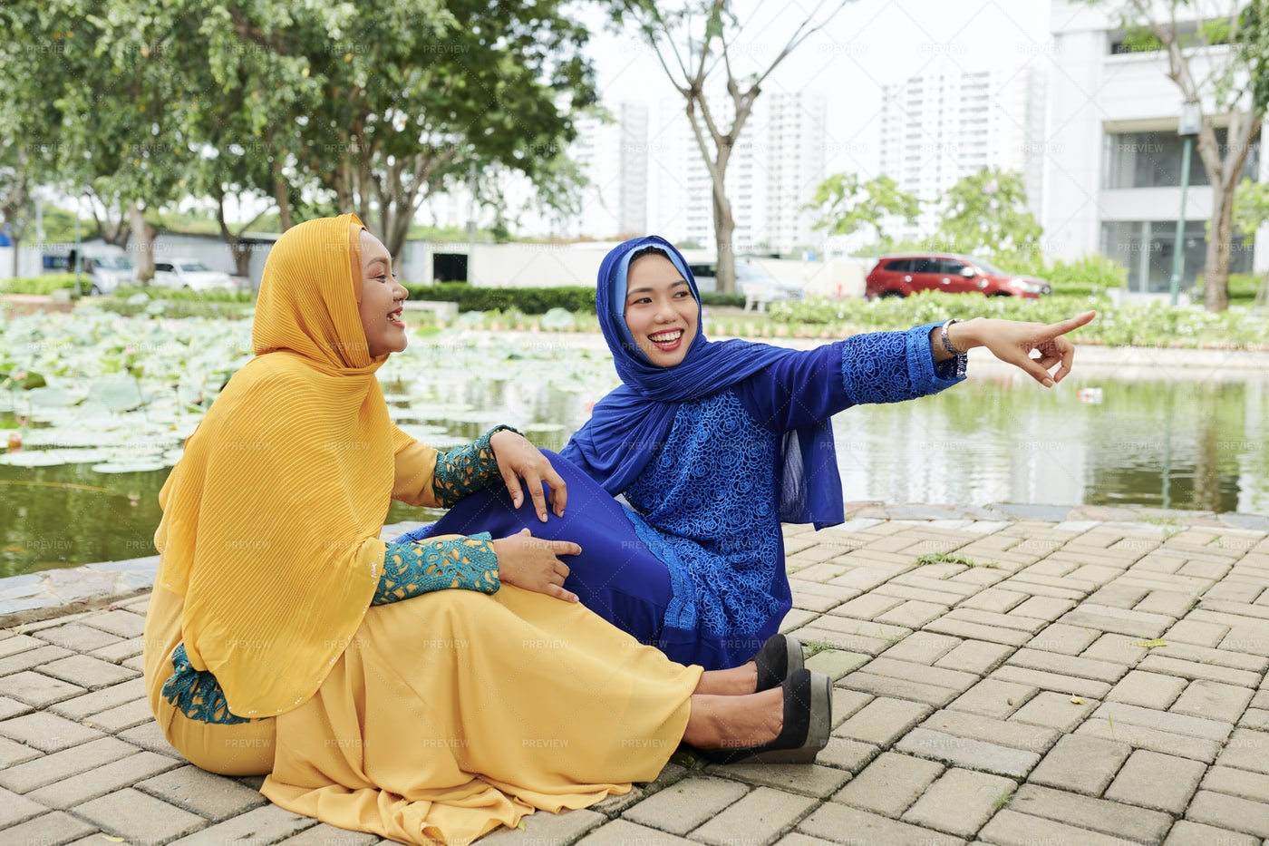 Cheerful Islamic Girls: Stock Photos