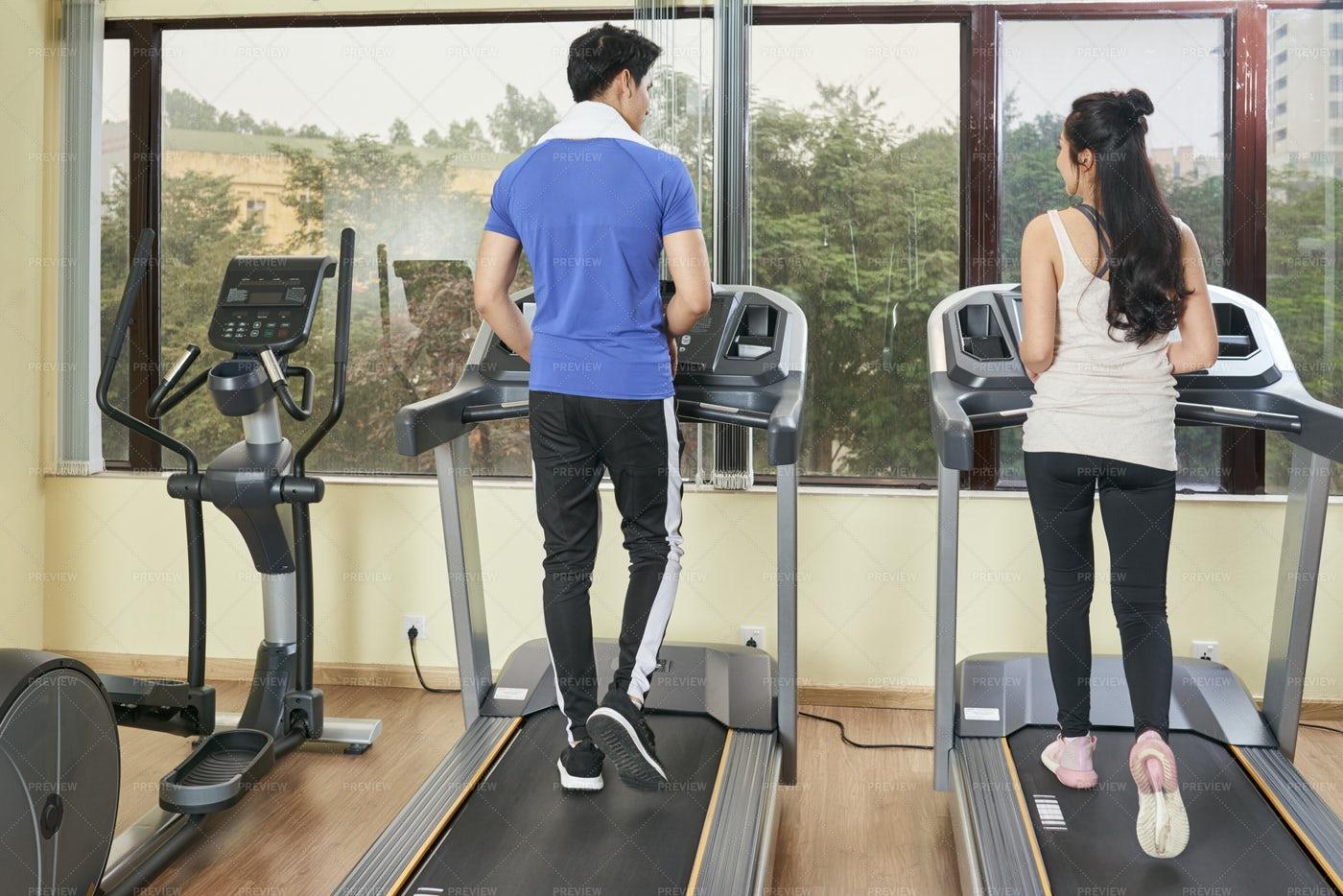 Couple Running On Treadmill: Stock Photos