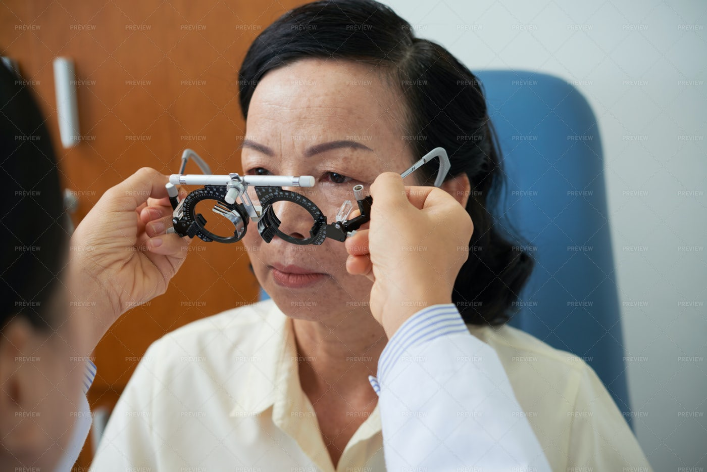 Woman Checking Her Eyesight In Clinic: Stock Photos