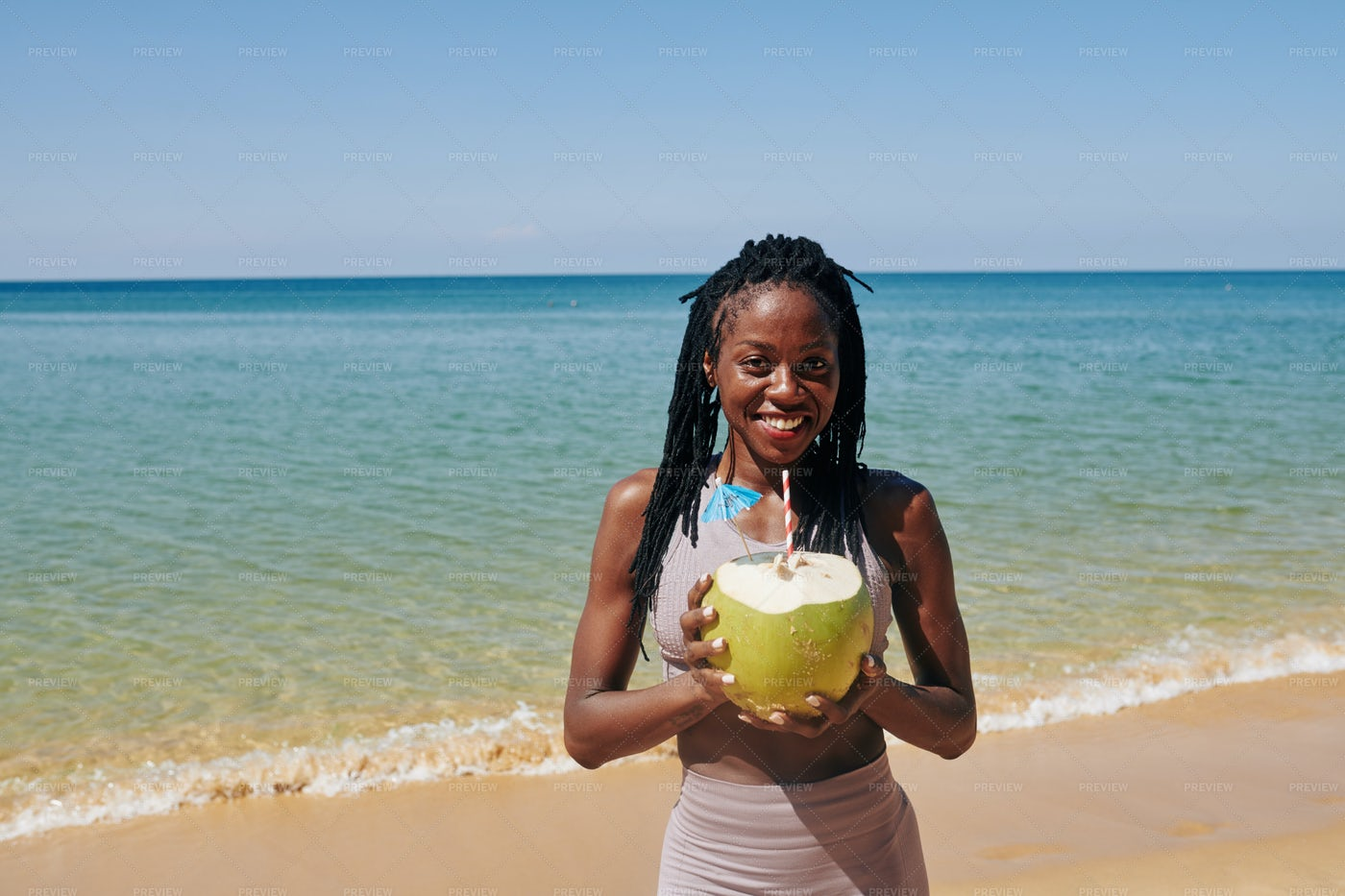 Young Woman With Big Green Coconut: Stock Photos