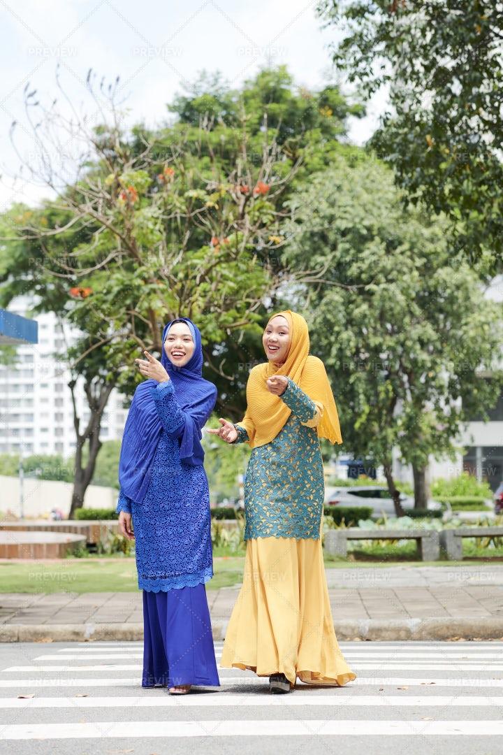 Cheerful Muslim Women In The City: Stock Photos