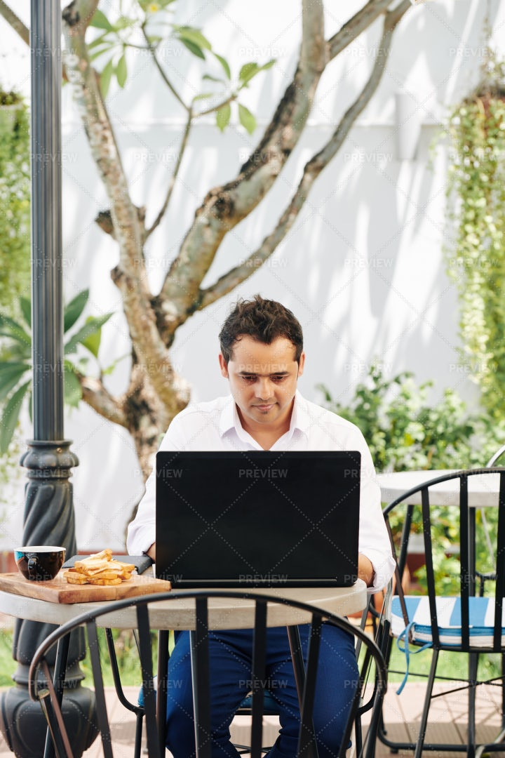 Indian Man Checking E-mails: Stock Photos