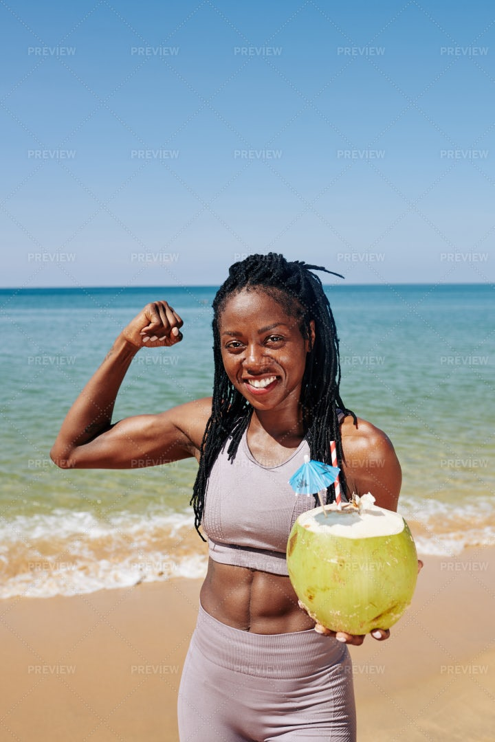 Sportswoman Showing Biceps Muscles: Stock Photos