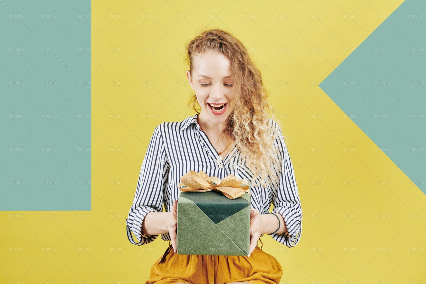 Excited Woman Looking At Birthday: Stock Photos