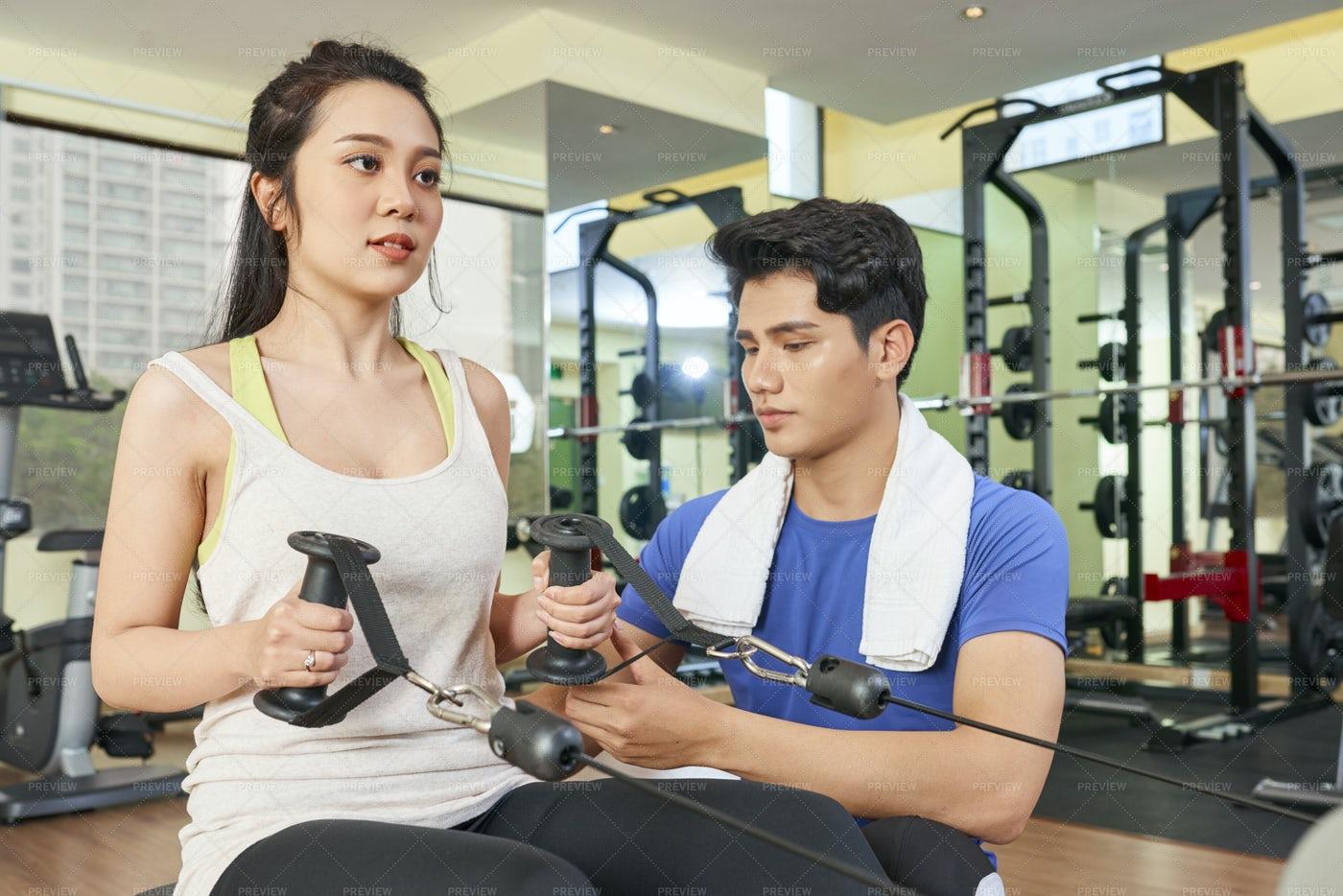 Woman Exercising With Coach: Stock Photos