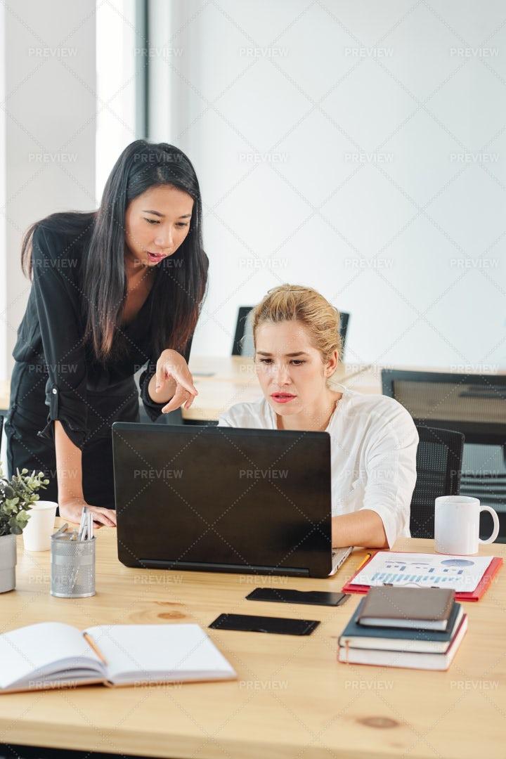 Businesswomen Using Laptop At Office: Stock Photos