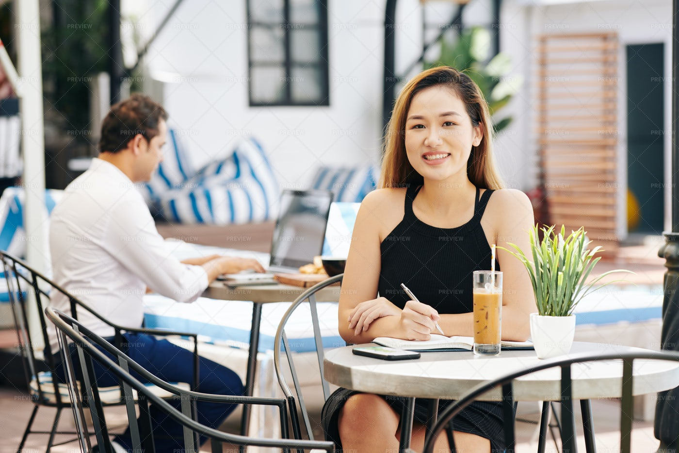 Beautiful Businesswoman At Cafe Table: Stock Photos
