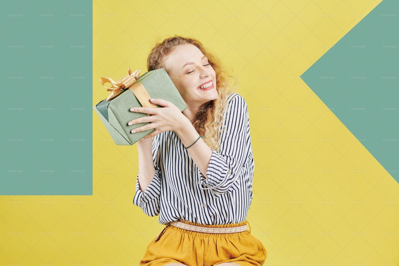 Pretty Woman Shaking Giftbox: Stock Photos