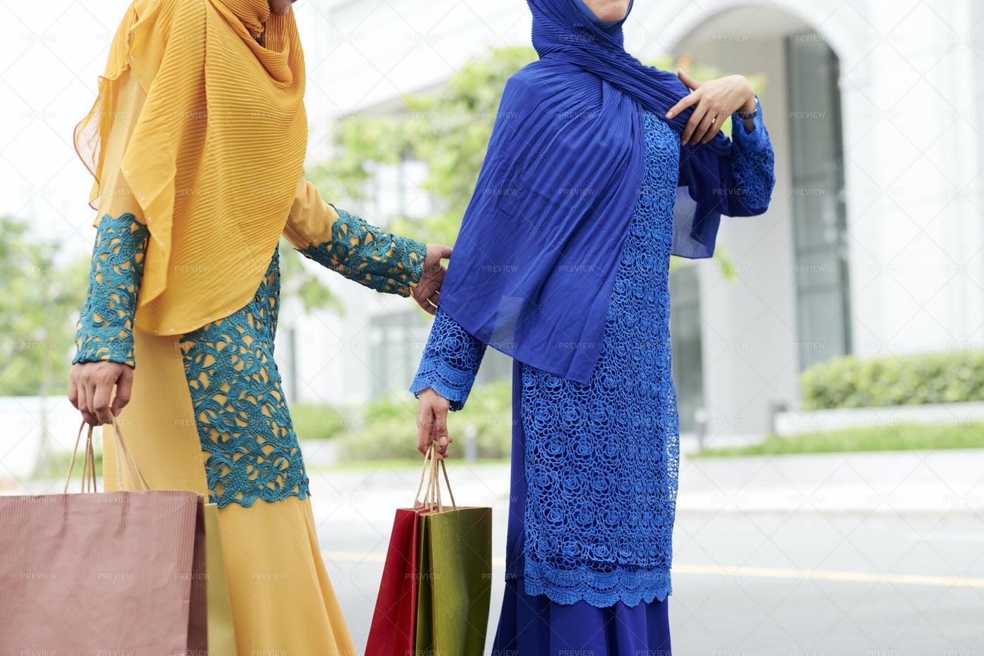 Muslim Women With Shopping Bags: Stock Photos