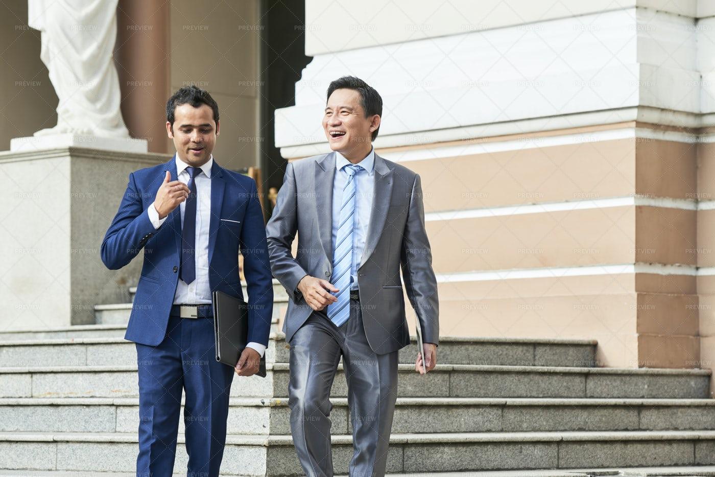 Businessmen Leaving Office Building: Stock Photos