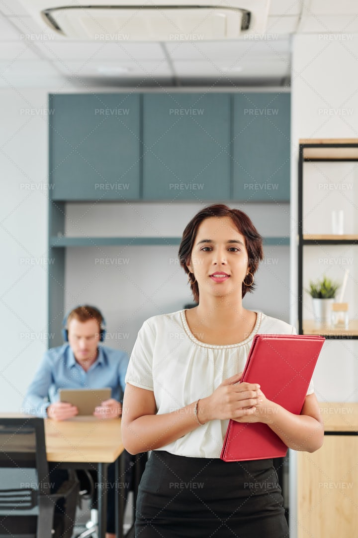 Businesswoman Walking Along The Office: Stock Photos