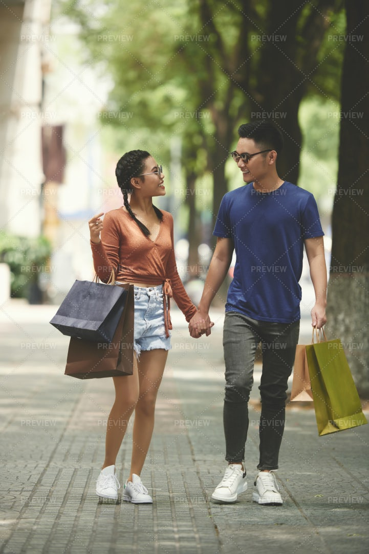 Young Couple Walking In The City: Stock Photos