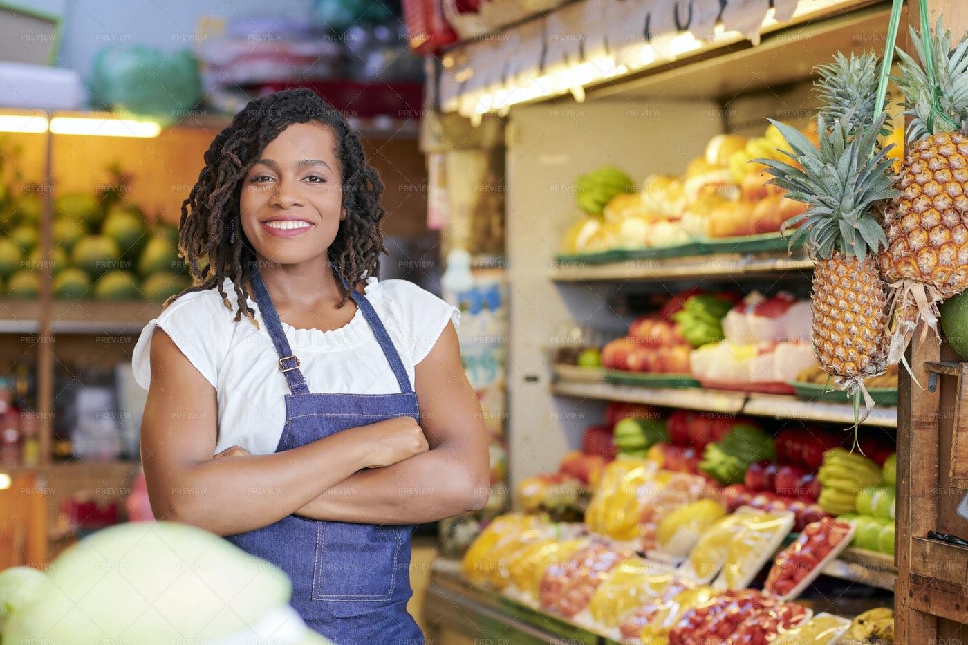 Pretty Grocery Store Saleswoman: Stock Photos