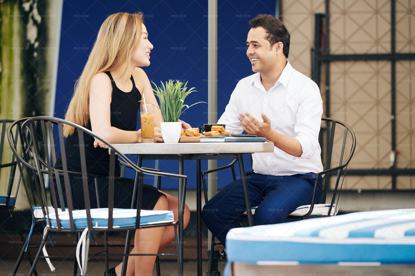 Couple Having Breakfast In Outdoor Cafe: Stock Photos