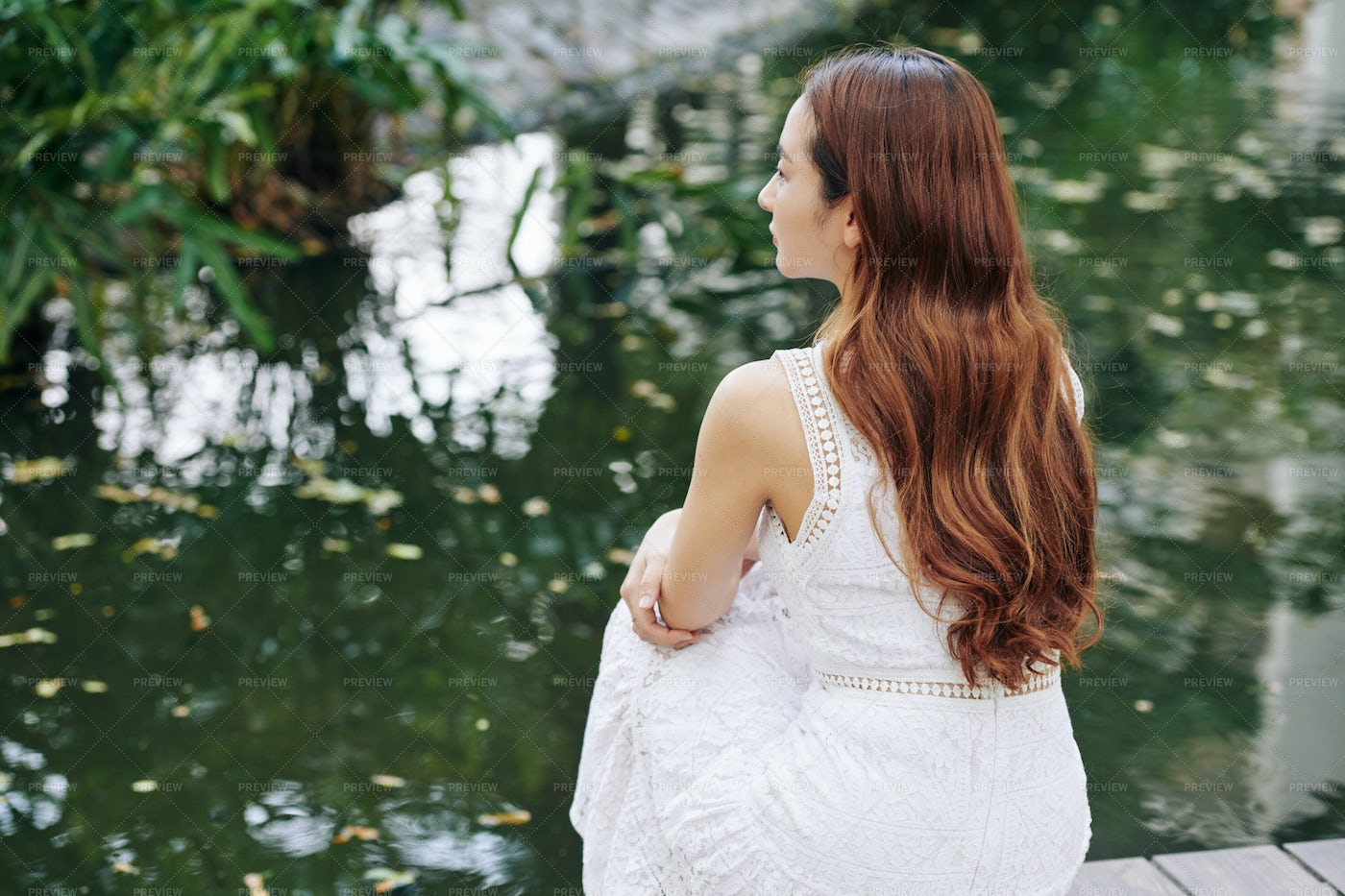 Dreamy Woman Looking At Pond: Stock Photos