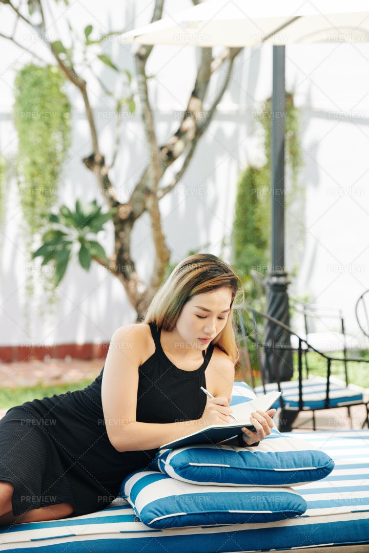 Businesswoman Taking Notes In Journal: Stock Photos
