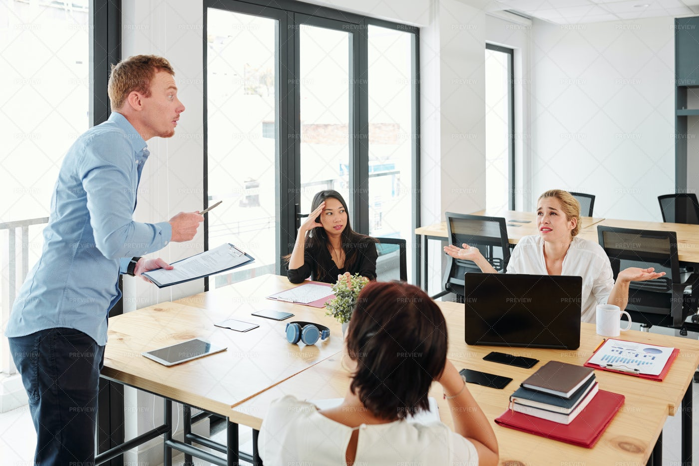 Leader With Business Team At Meeting: Stock Photos