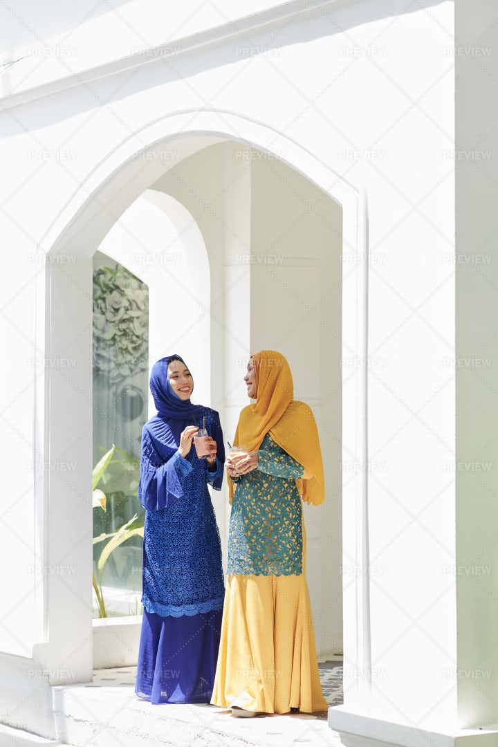 Muslim Women Chatting At Party: Stock Photos