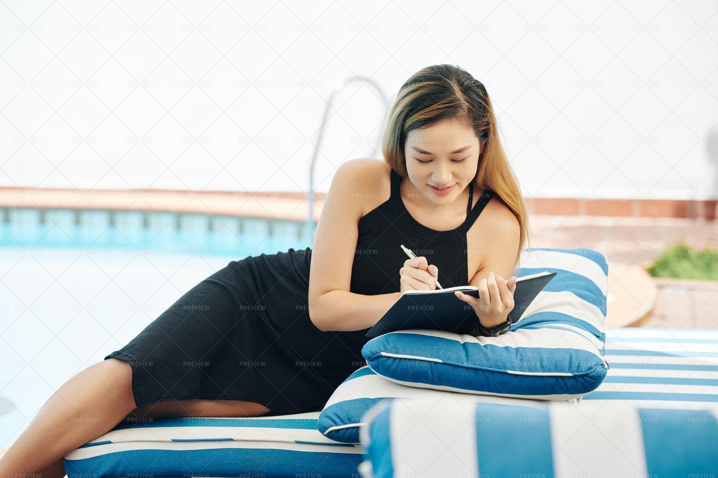 Young Woman Filling Gratitude Journal: Stock Photos