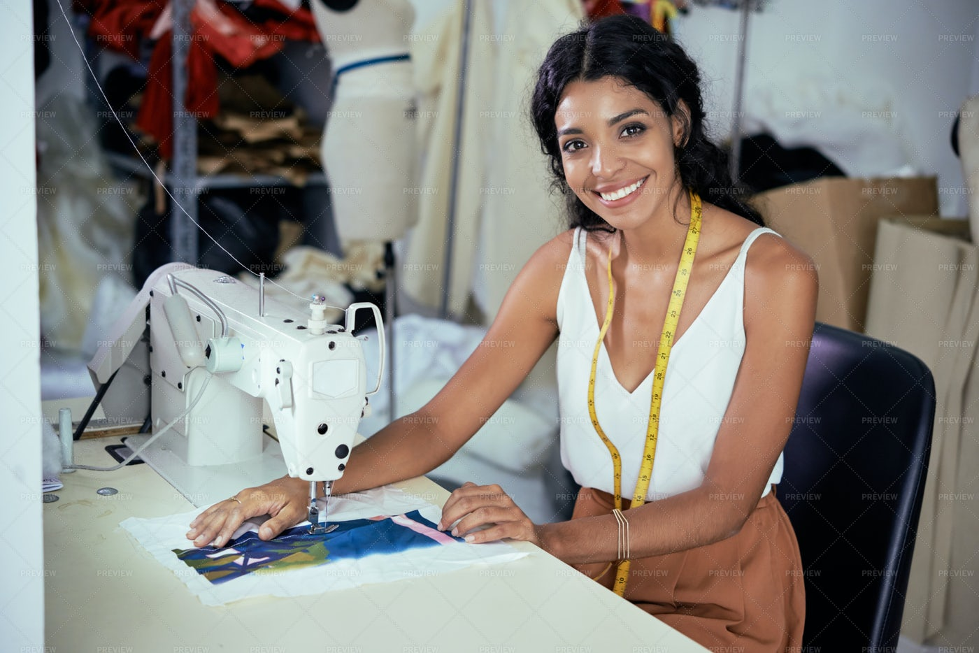 Seamstress Working On Sewing Machine: Stock Photos