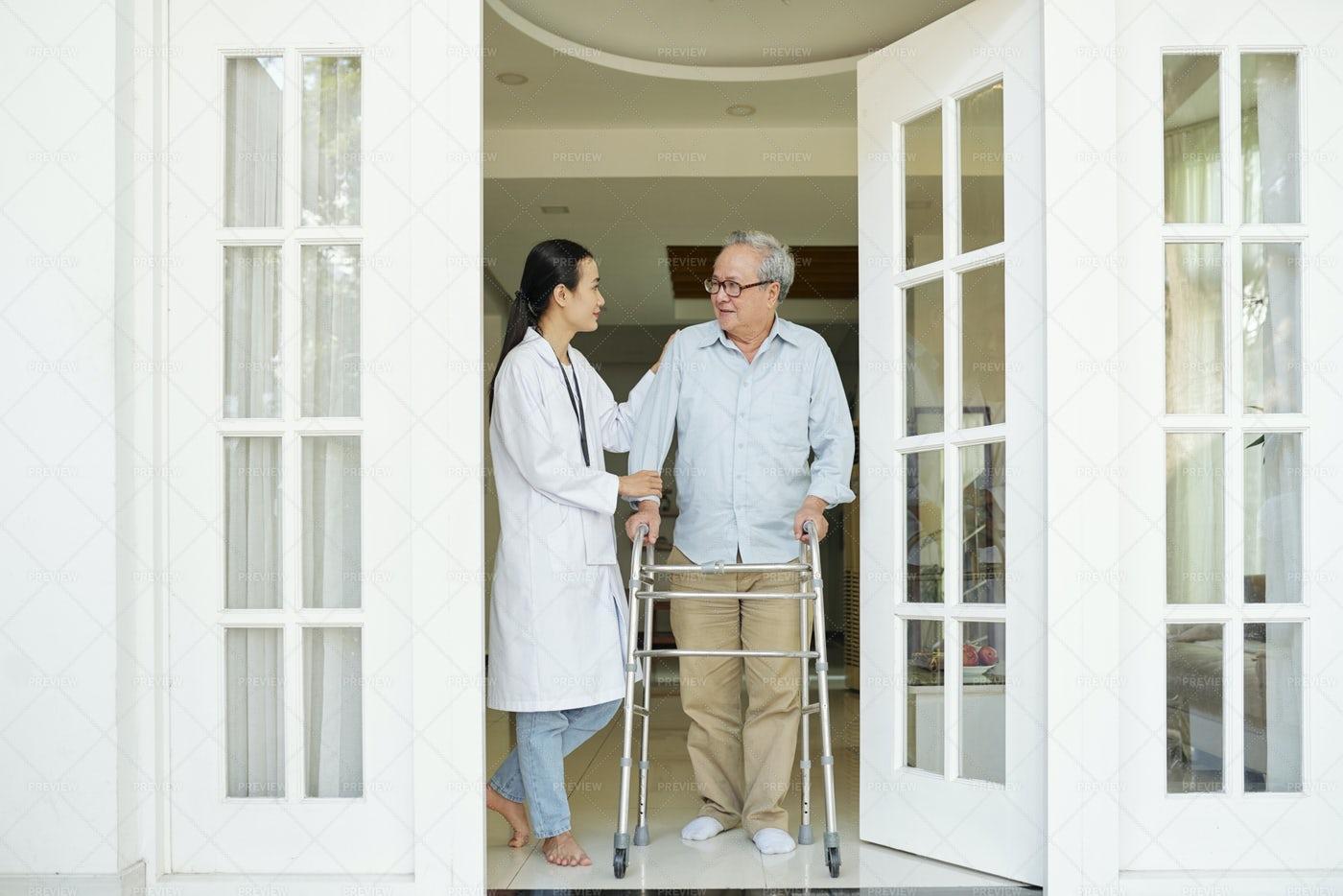 Senior Man With Nurse Is Going To Walk: Stock Photos