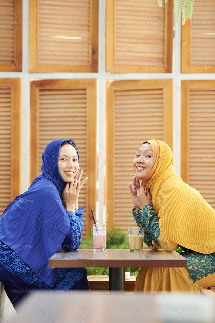 Happy Female Friends Meeting In Cafe: Stock Photos