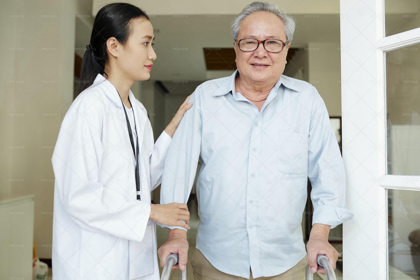 Nurse Helping Young Man To Move: Stock Photos