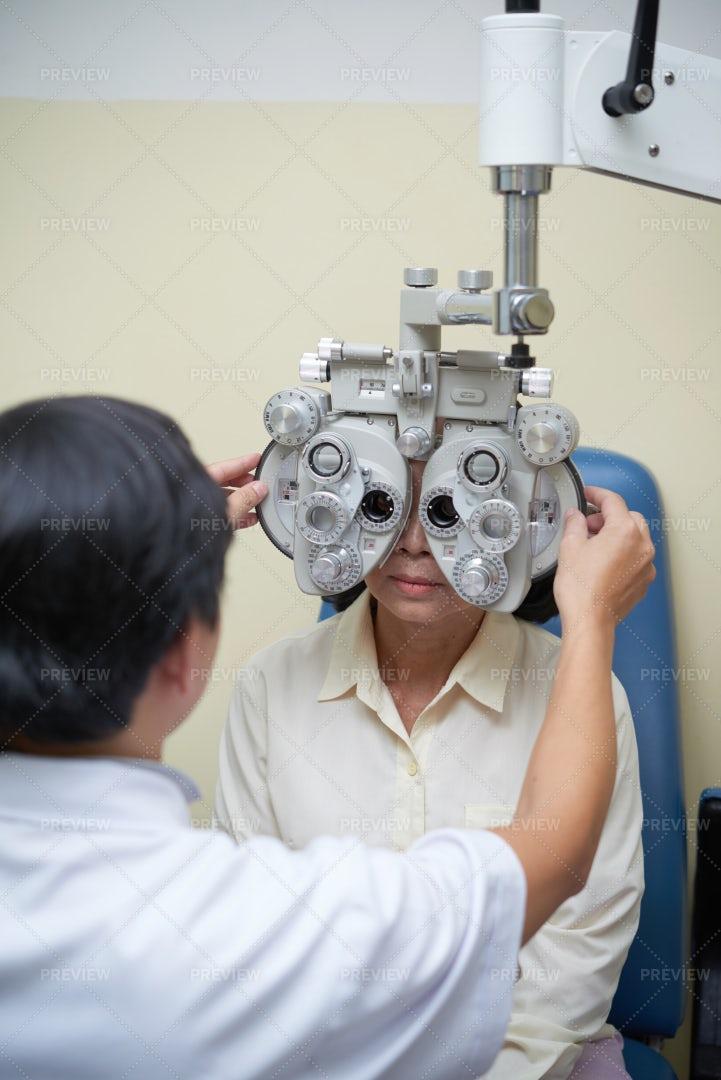 Doctor Examining Patient's Eyesight: Stock Photos