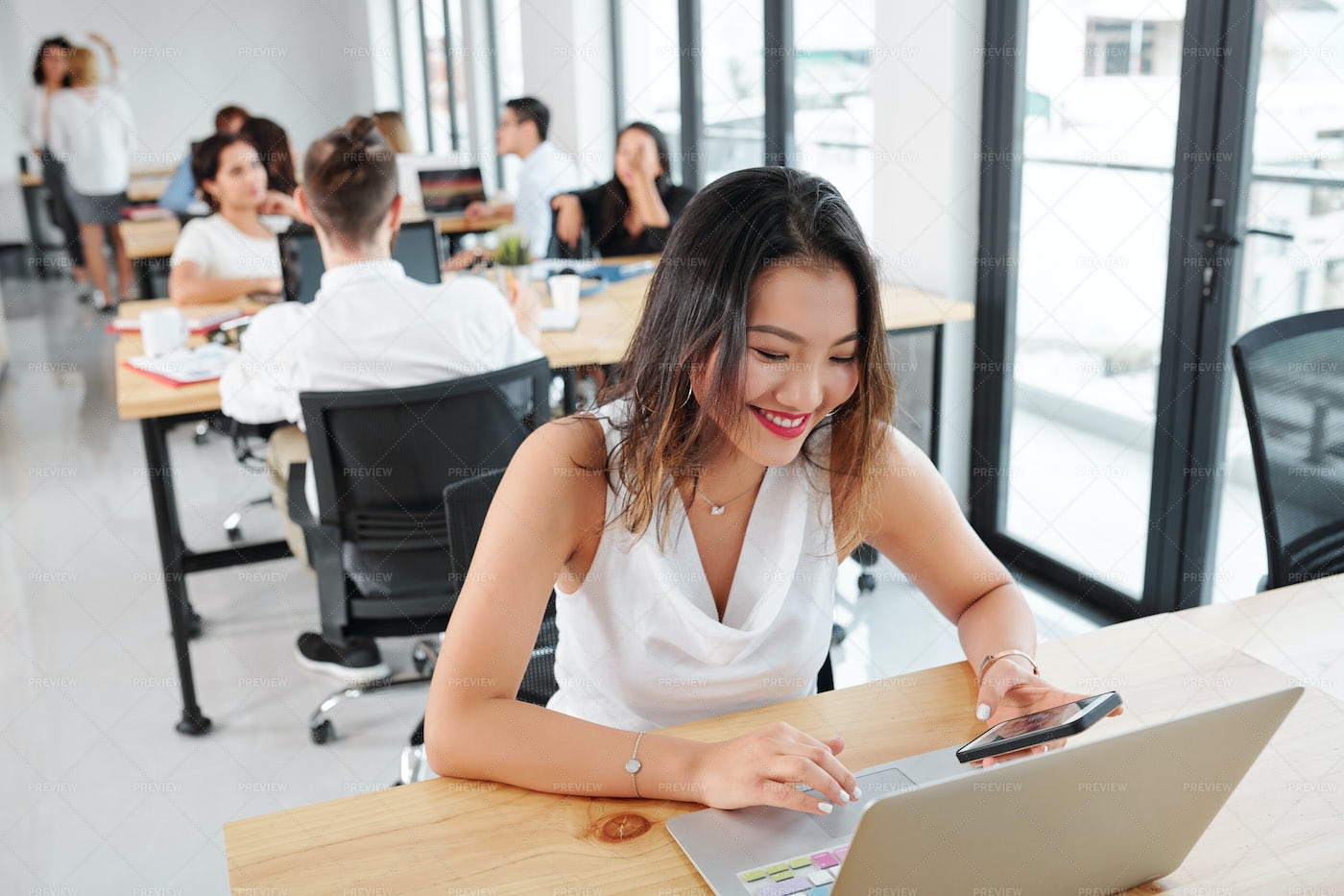 Businesswoman Working At Her Workplace: Stock Photos