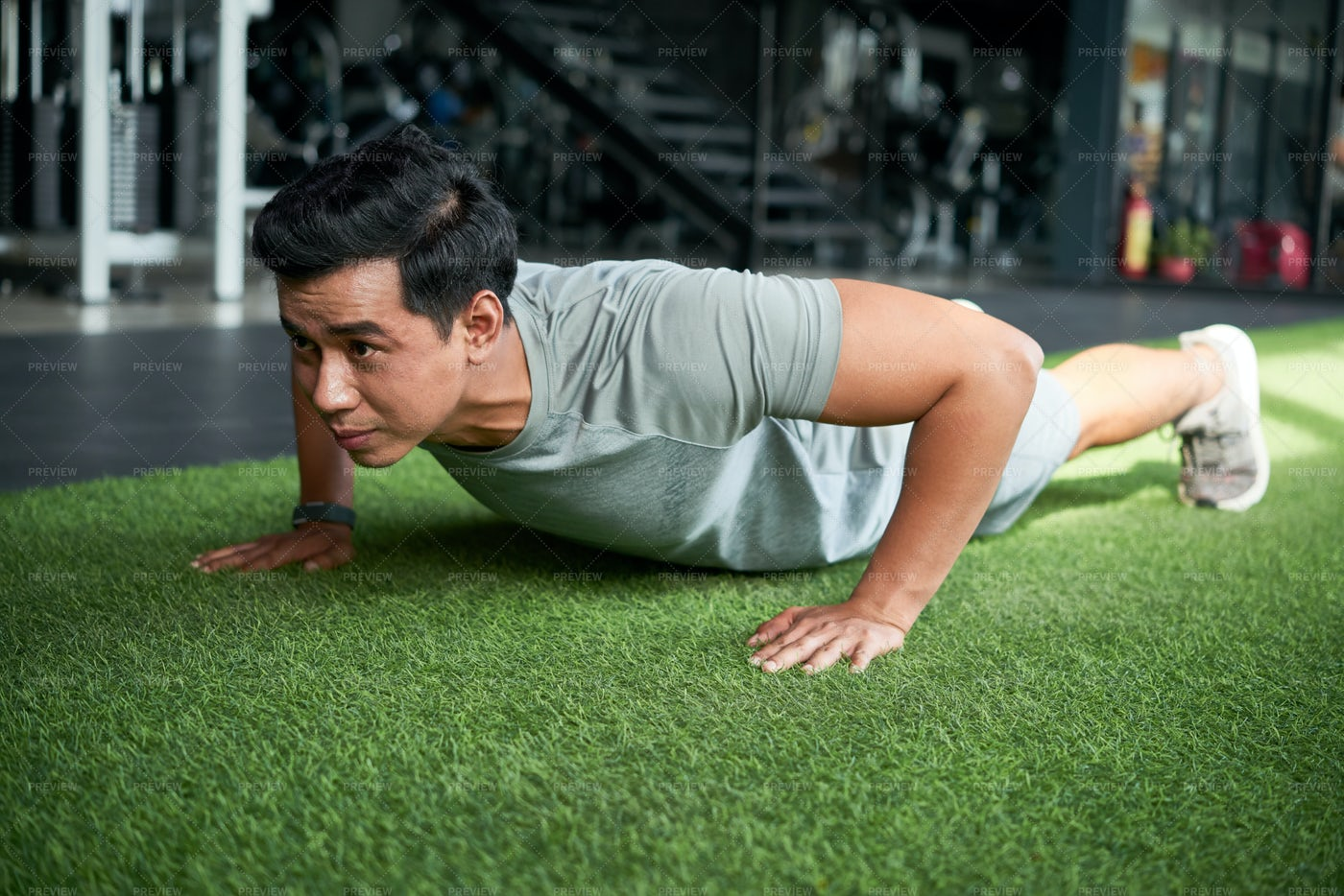 Man Exercising In Fitness Club: Stock Photos