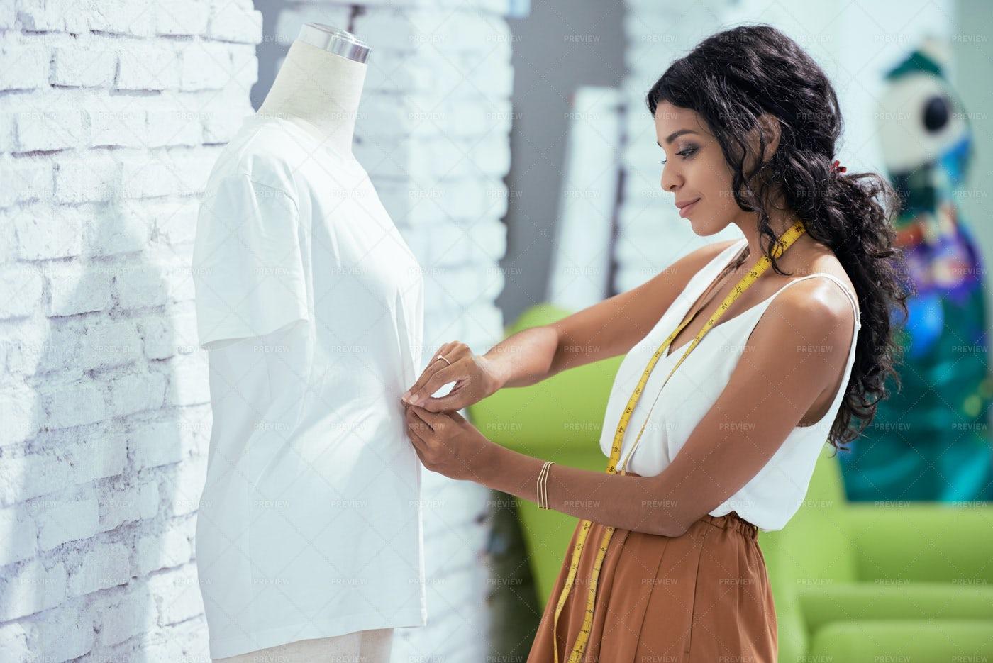 Tailor Pinning T-shirt On Mannequin: Stock Photos