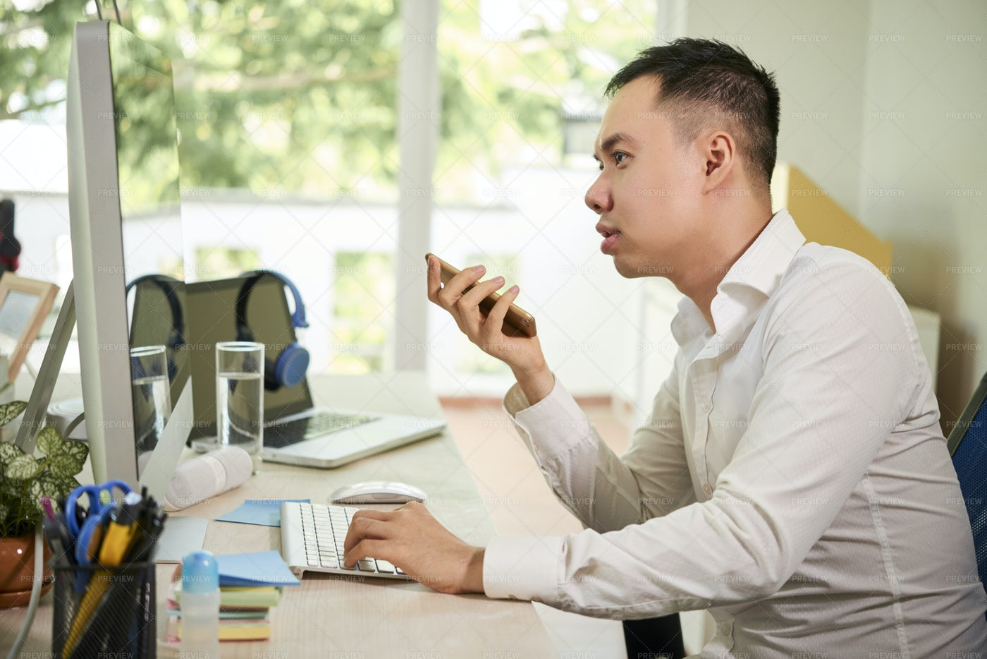 Businessman Consults On The Phone At: Stock Photos