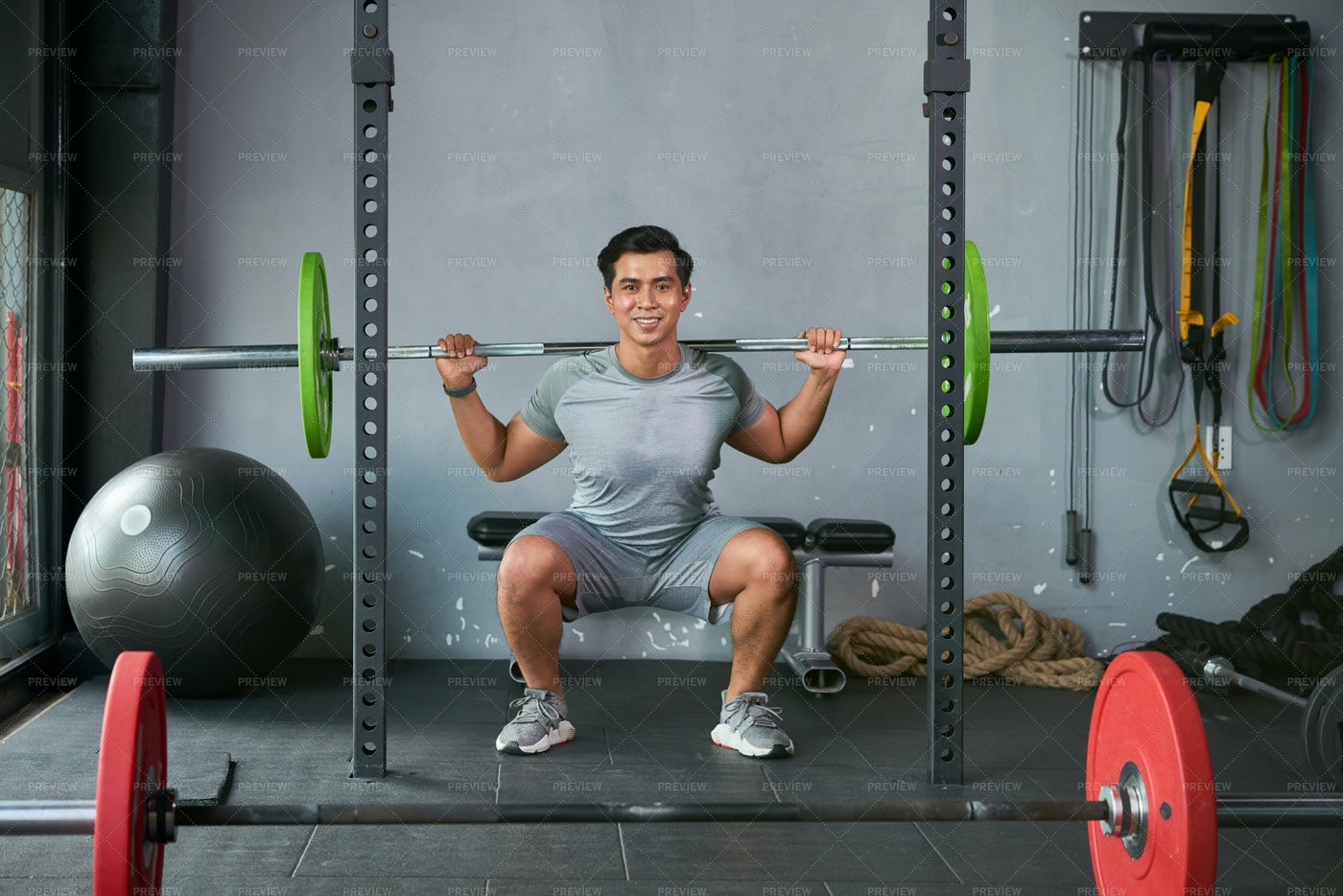 Man Lifting Dumbbell In Gym: Stock Photos