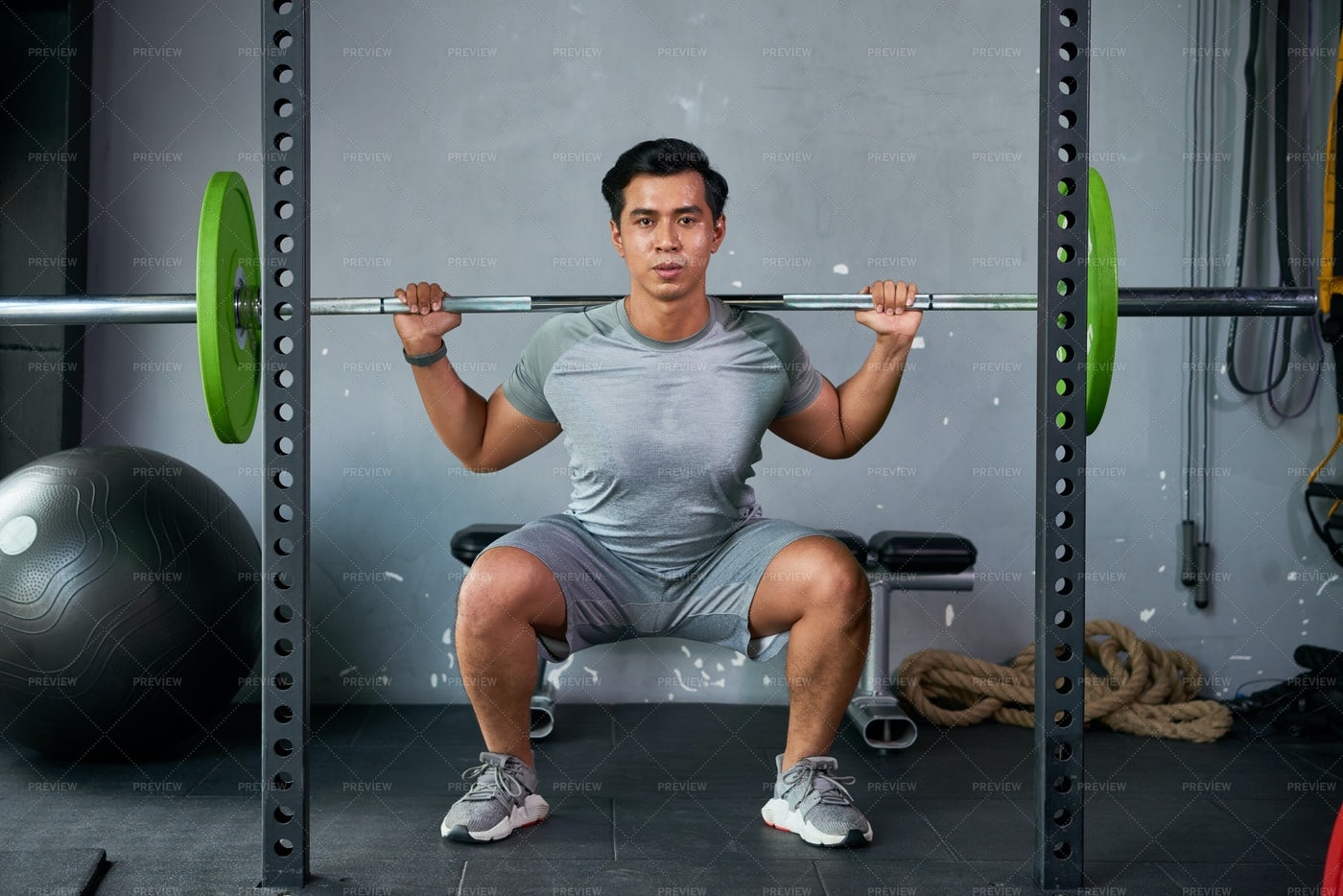 Bodybuilder Exercising With Dumbbell: Stock Photos