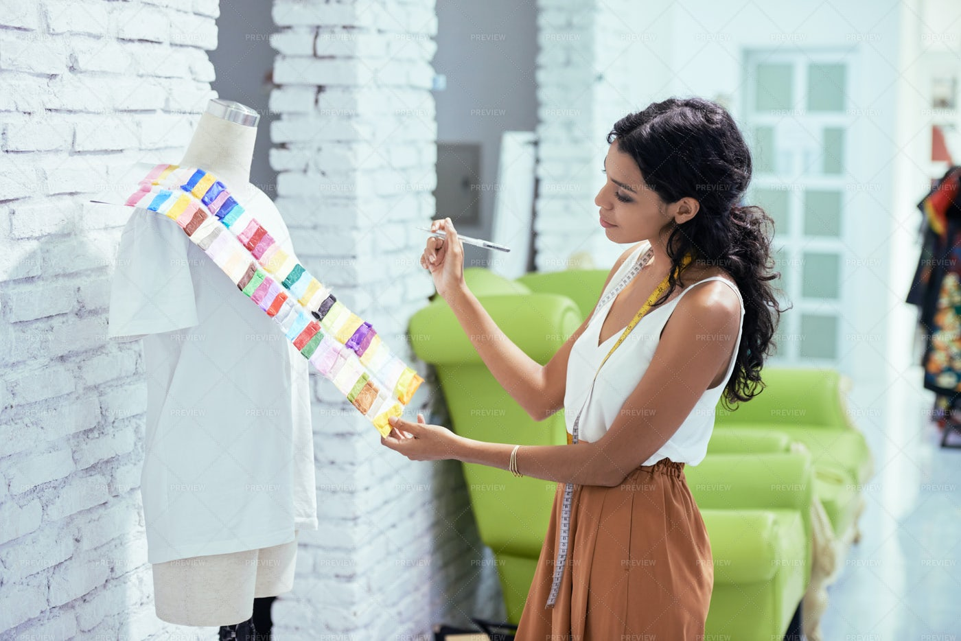 Seamstress Choosing Fabric For New: Stock Photos