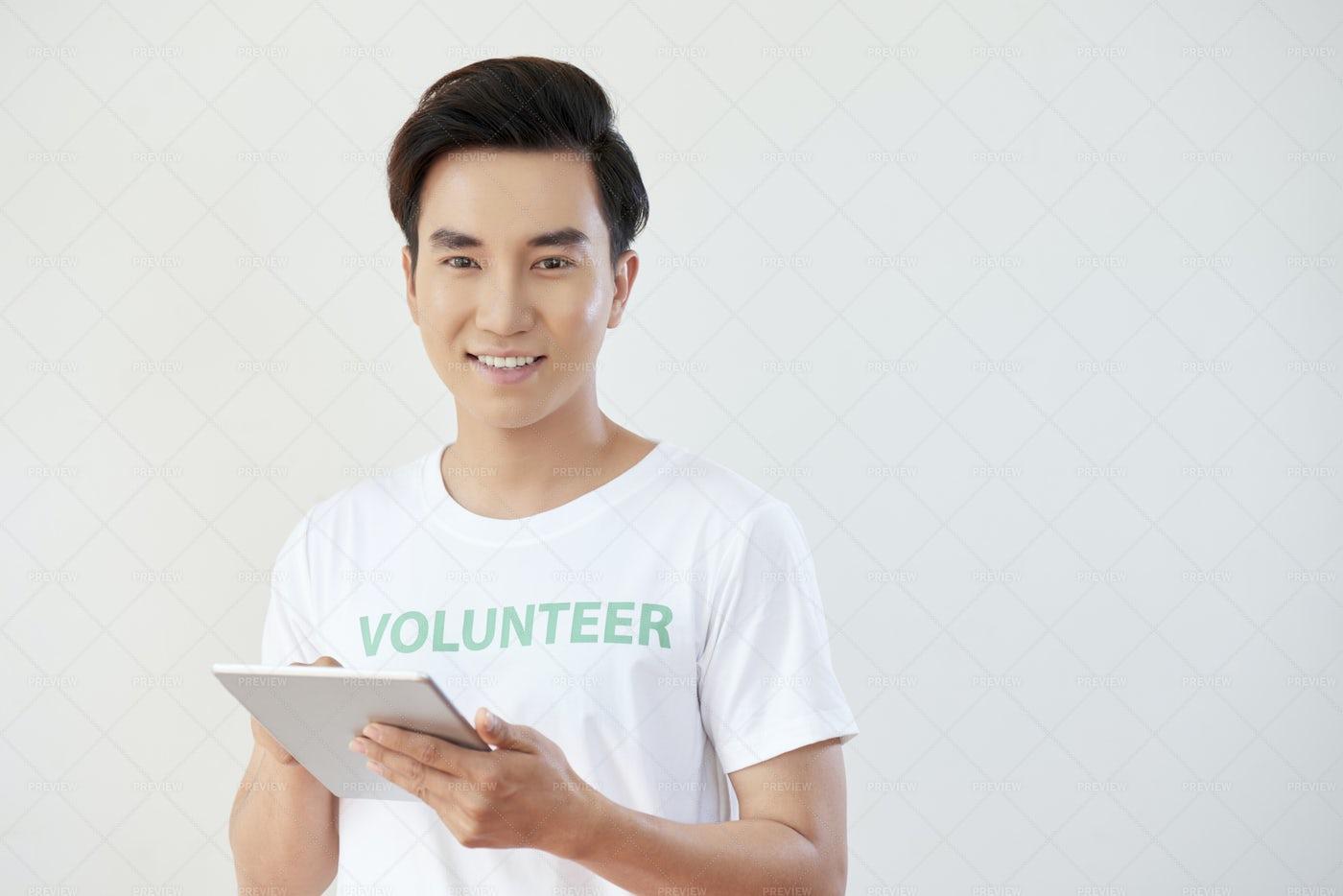 Volunteer Working Online: Stock Photos