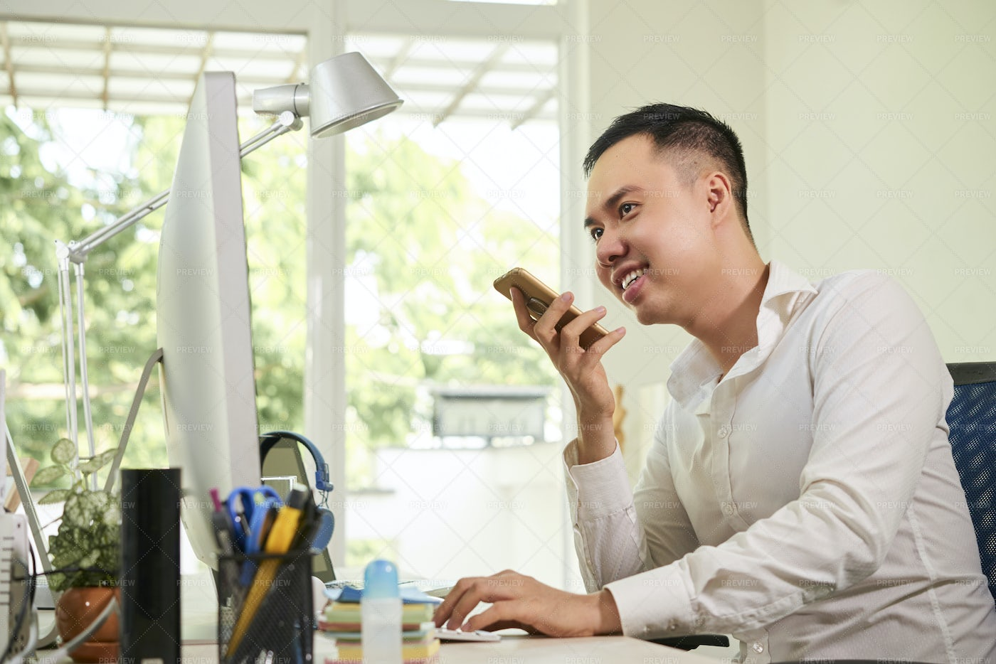 Office Worker Talking On The Phone: Stock Photos