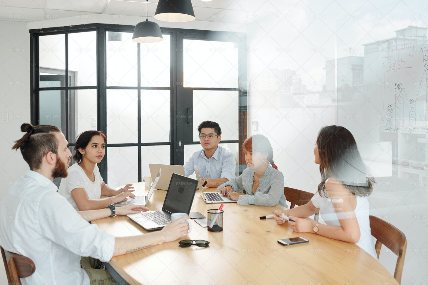 Business People Working At Board Room: Stock Photos