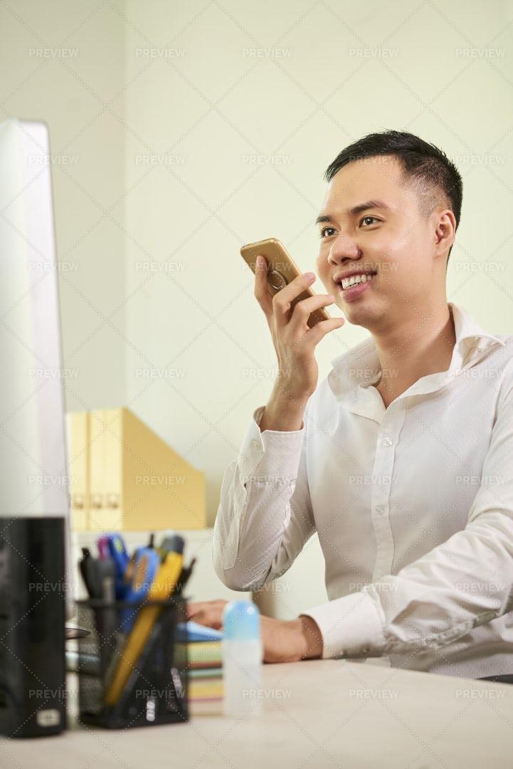 Businessman Recording An Audio Message: Stock Photos