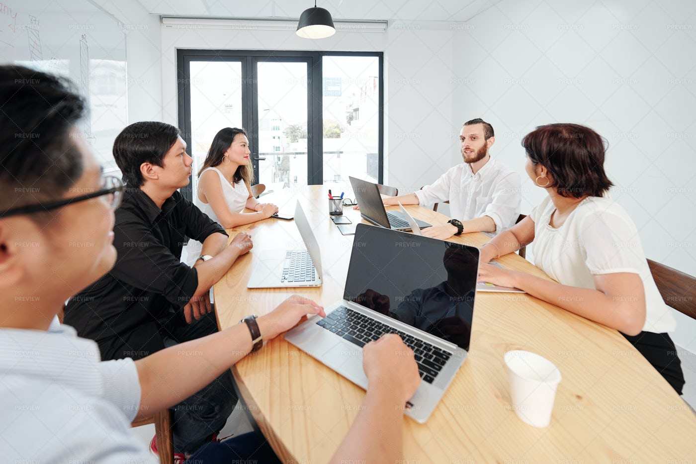 Teamwork At Board Room: Stock Photos