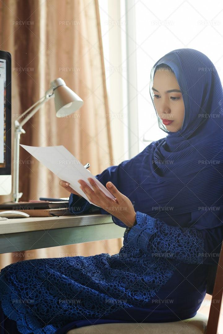 Muslim Businesswoman Reading Financial: Stock Photos