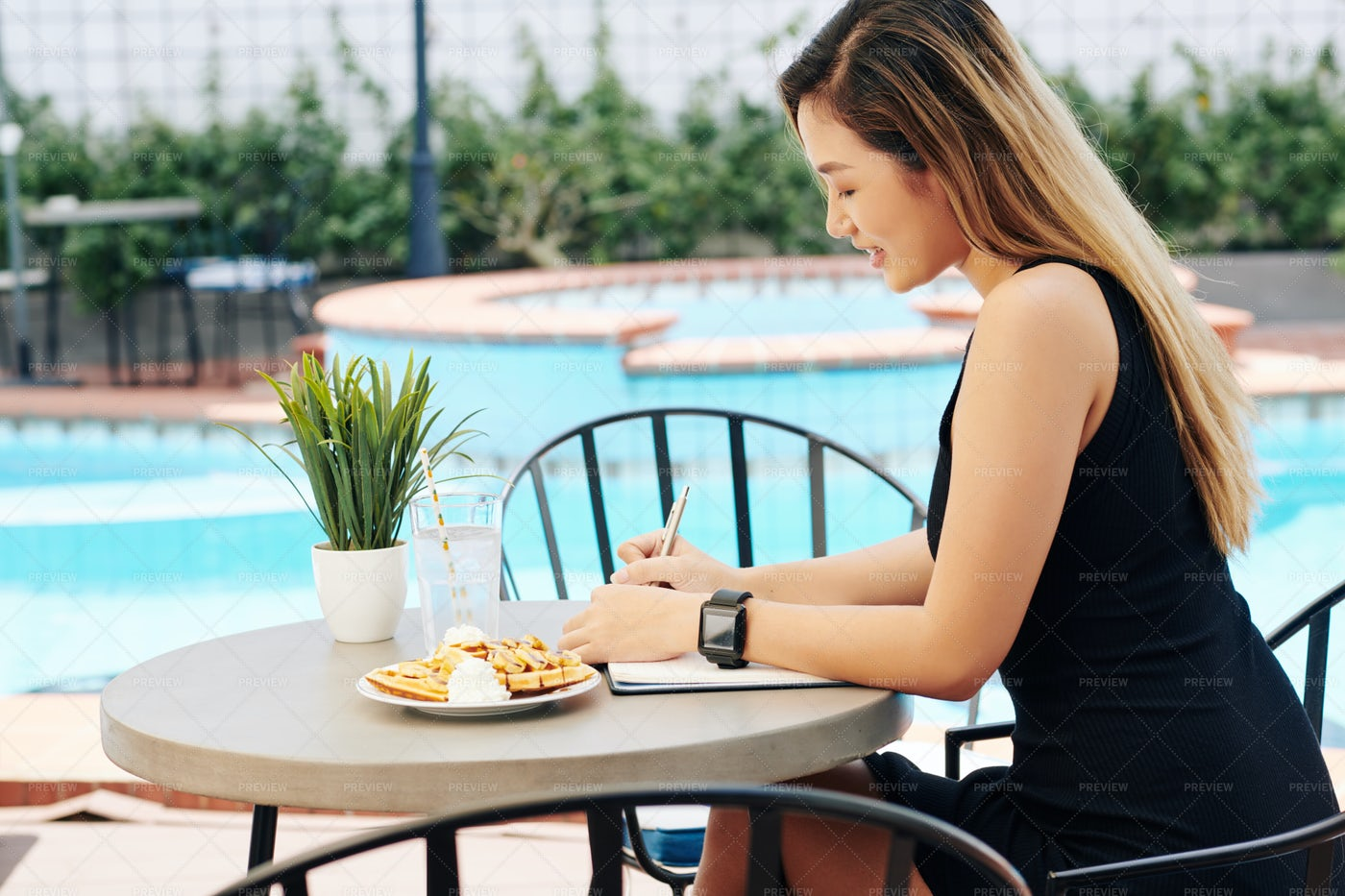 Woman Eating Breakfast And Filling: Stock Photos