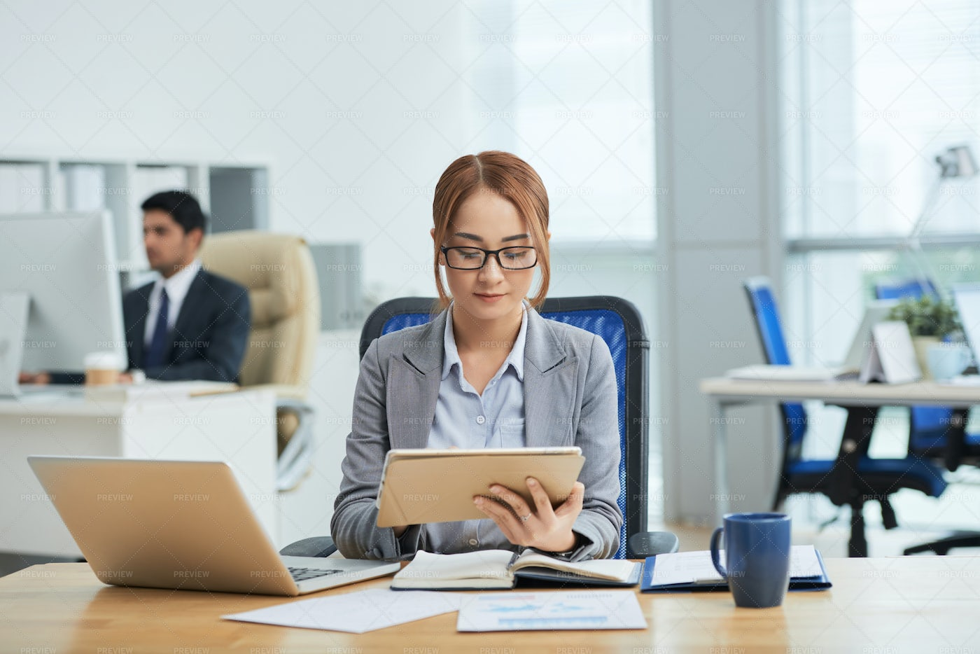 Businesswoman Using Tablet Pc In Her: Stock Photos
