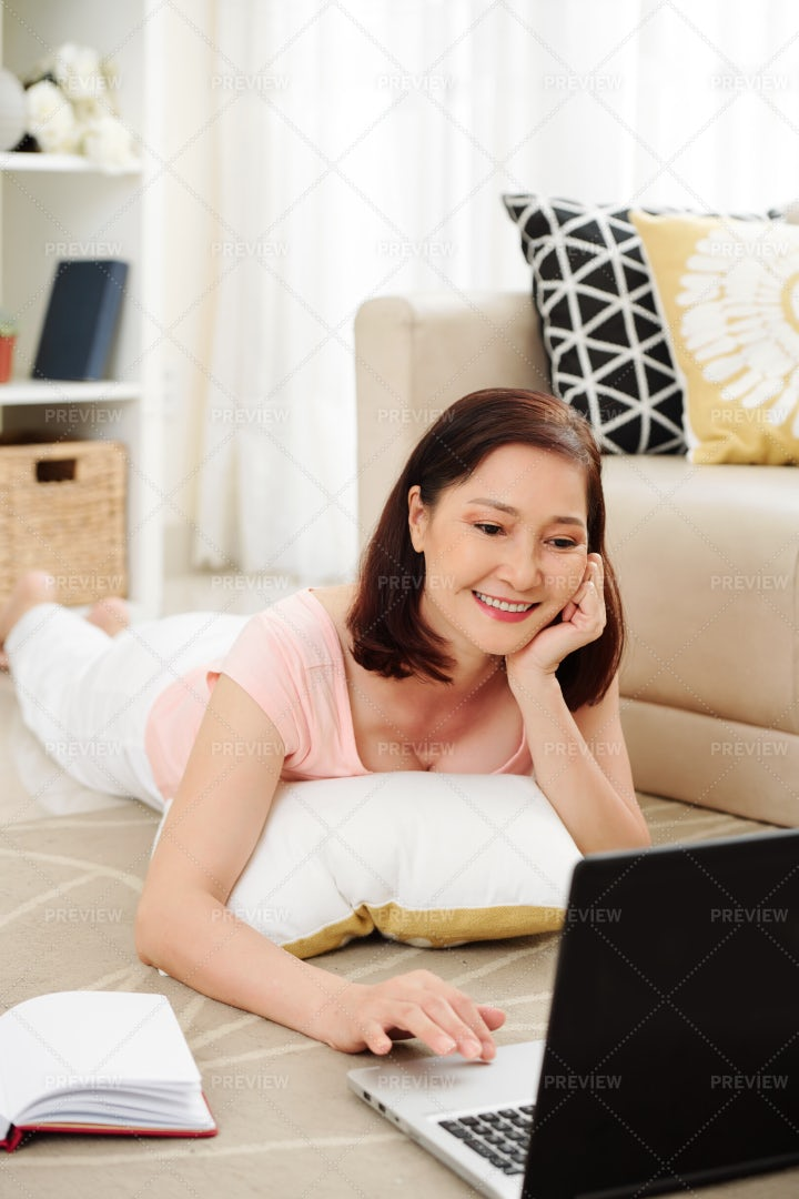 Pretty Woman Checking Social Media: Stock Photos