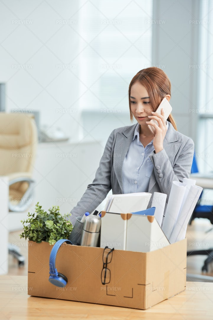 Businesswoman Moving To A New Office: Stock Photos