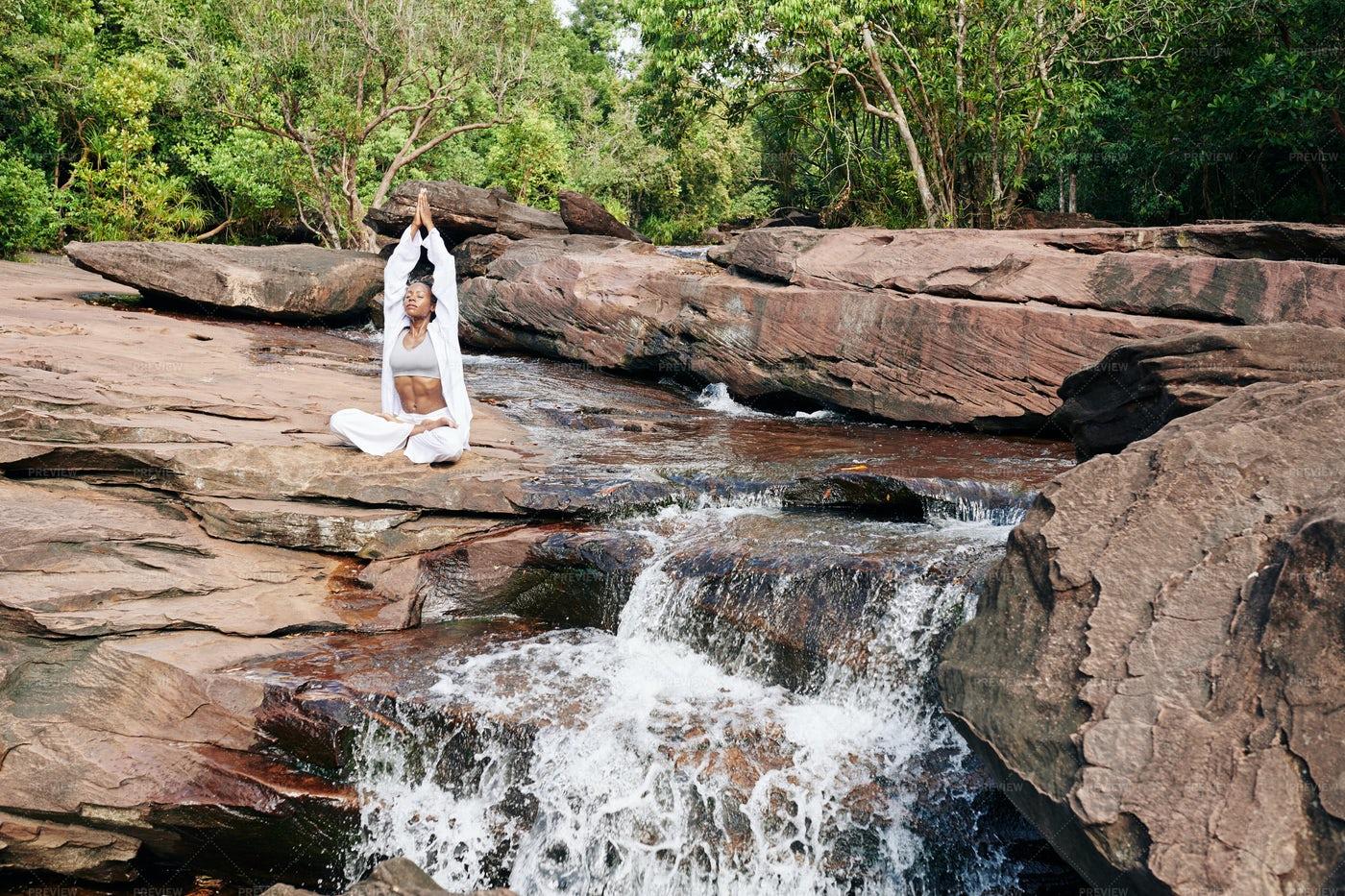 Woman Meditating In Nature: Stock Photos