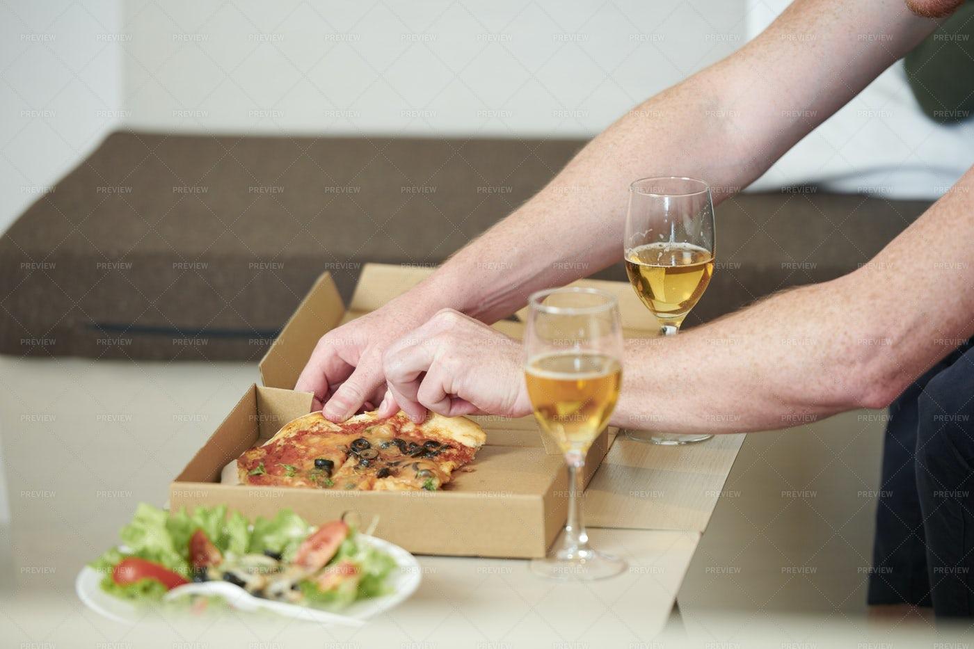 Man Taking Slice Of Pizza: Stock Photos