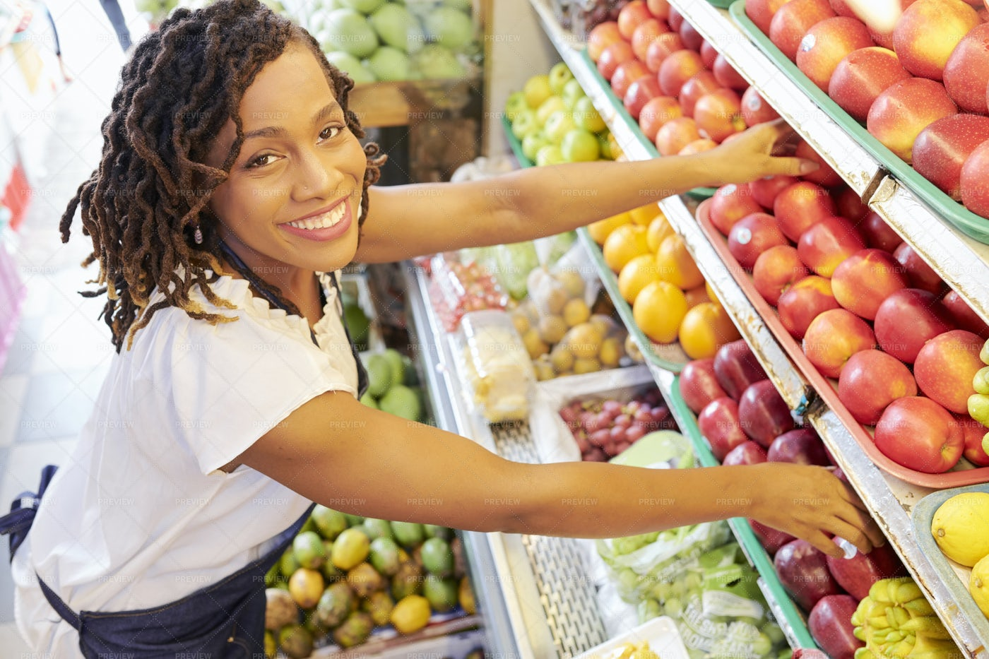 Woman Working At Fruit Department: Stock Photos