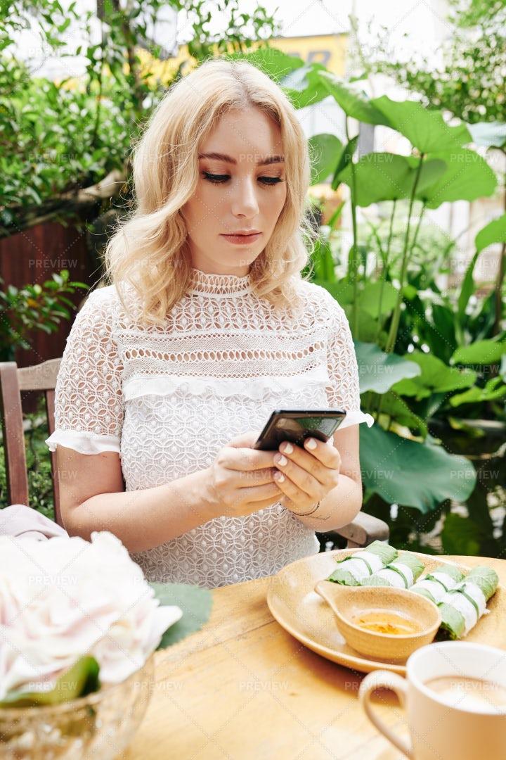 Young Woman Checking Social Media: Stock Photos